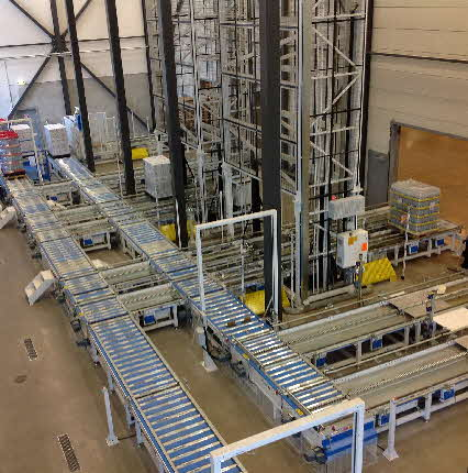 Vertical Lift Pallet Conveyors Being  Fed by Live Roller Conveyor and 3-Strand Chain Conveyor